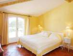 Luxury Villa Rental yellow bedroom